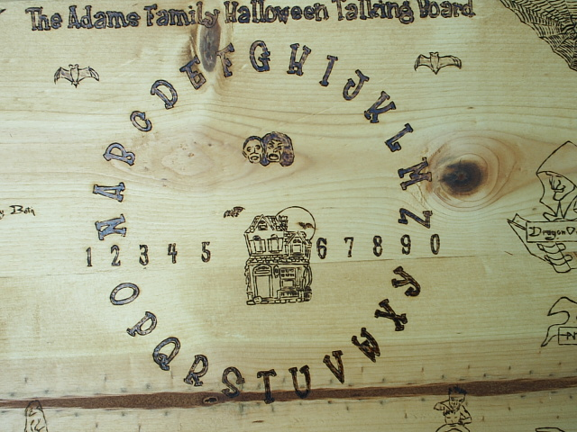A haunted house, vampires, and bats center this board near frost type lettering and numerals